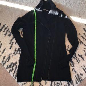 Medium length asymmetrical black cardigan